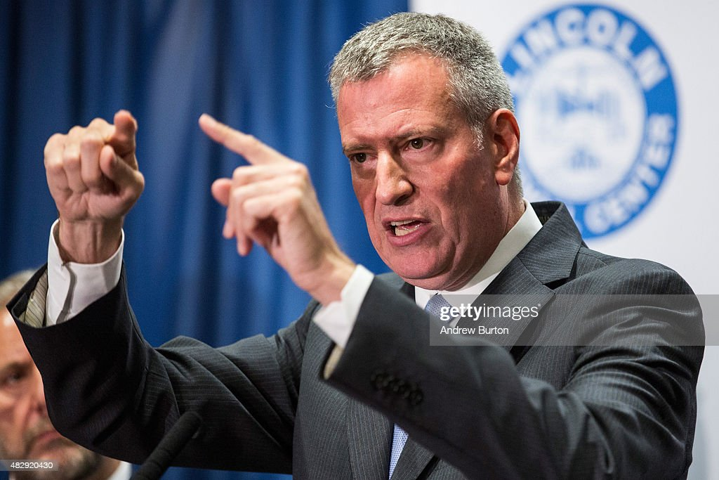 New York City Mayor <a gi-track='captionPersonalityLinkClicked' href=/galleries/search?phrase=Bill+de+Blasio&family=editorial&specificpeople=6224514 ng-click='$event.stopPropagation()'>Bill de Blasio</a> speaks at a press conference to address the Legionnaire's disease outbreak in the city at Lincoln Hospital on August 4, 2015 in the Bronx borough of New York City. The disease - which is not contagious - has been found in five building water cooling systems, which has infected at least 86 people and killed seven since July as of August 4.