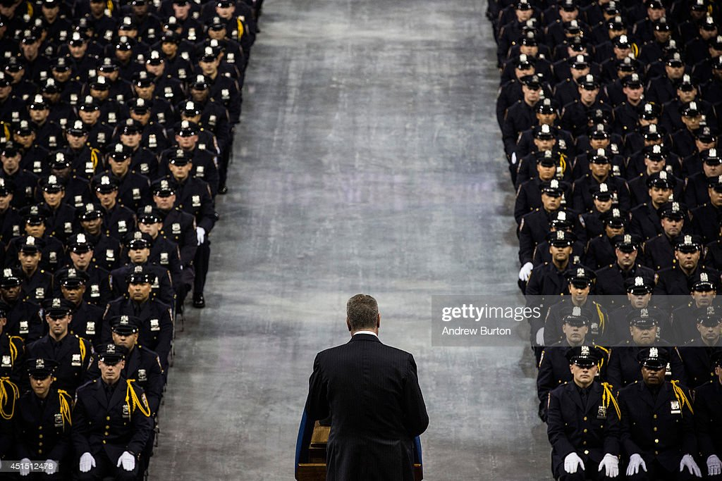New York City Mayor Bill De Blasio speaks at the 2014 graduation ceremony for the New York Police Department (NYPD) on June 30, 2014 at Madison Square Garden in New York City. The NYPD, which has over 35,000 officers, graduated 604 new officers today.