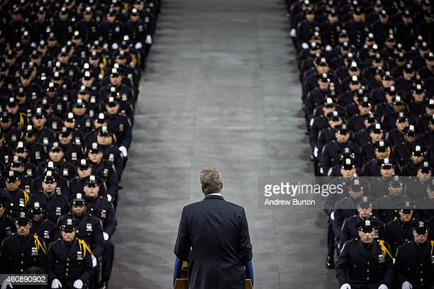 New York City Mayor Bill de Blasio speaks at the New York Police Department graduation ceremony at Madison Square Garden on December 29 2014 in New...