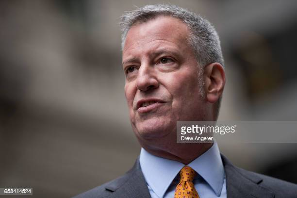 New York City Mayor Bill De Blasio speaks to reporters during a media availability with the 'Fearless Girl' statue March 27 2017 in New York City De...