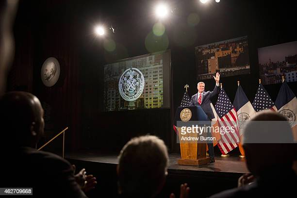 New York City Mayor Bill de Blasio waves to the crowd before delivering his State of the City address at Baruch College on February 3 2015 in New...