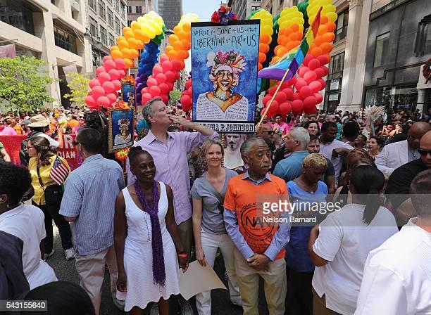 New York City Mayor Mayor Bill de Blasio with wife Chirlane McCray actress Cynthia Nixon and activist Al Sharpton march during the New York City...