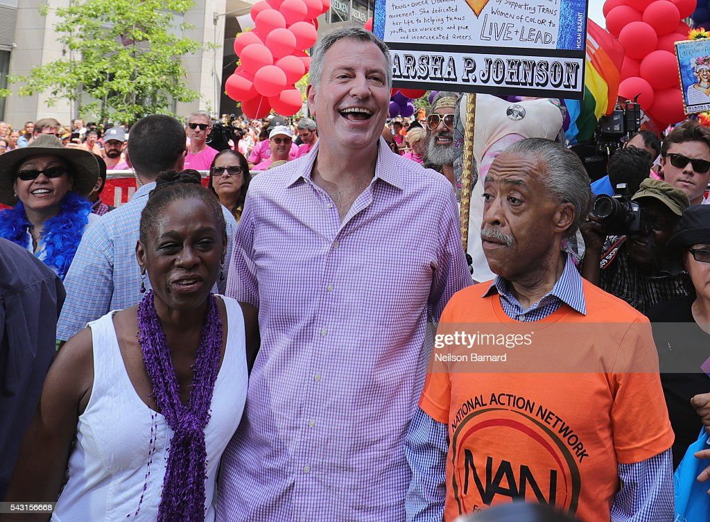 New York City Mayor Mayor <a gi-track='captionPersonalityLinkClicked' href=/galleries/search?phrase=Bill+de+Blasio&family=editorial&specificpeople=6224514 ng-click='$event.stopPropagation()'>Bill de Blasio</a> with wife <a gi-track='captionPersonalityLinkClicked' href=/galleries/search?phrase=Chirlane+McCray&family=editorial&specificpeople=8014891 ng-click='$event.stopPropagation()'>Chirlane McCray</a> and activist <a gi-track='captionPersonalityLinkClicked' href=/galleries/search?phrase=Al+Sharpton&family=editorial&specificpeople=202250 ng-click='$event.stopPropagation()'>Al Sharpton</a> march during the New York City Pride 2016 march on June 26, 2016 in New York City.