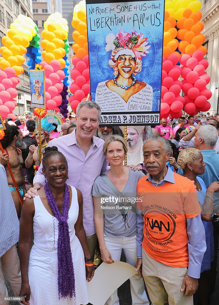 New York City Mayor Mayor <a gi-track='captionPersonalityLinkClicked' href=/galleries/search?phrase=Bill+de+Blasio&family=editorial&specificpeople=6224514 ng-click='$event.stopPropagation()'>Bill de Blasio</a> with wife <a gi-track='captionPersonalityLinkClicked' href=/galleries/search?phrase=Chirlane+McCray&family=editorial&specificpeople=8014891 ng-click='$event.stopPropagation()'>Chirlane McCray</a>, actress <a gi-track='captionPersonalityLinkClicked' href=/galleries/search?phrase=Cynthia+Nixon&family=editorial&specificpeople=202583 ng-click='$event.stopPropagation()'>Cynthia Nixon</a> and activist <a gi-track='captionPersonalityLinkClicked' href=/galleries/search?phrase=Al+Sharpton&family=editorial&specificpeople=202250 ng-click='$event.stopPropagation()'>Al Sharpton</a> march during the New York City Pride 2016 march on June 26, 2016 in New York City.