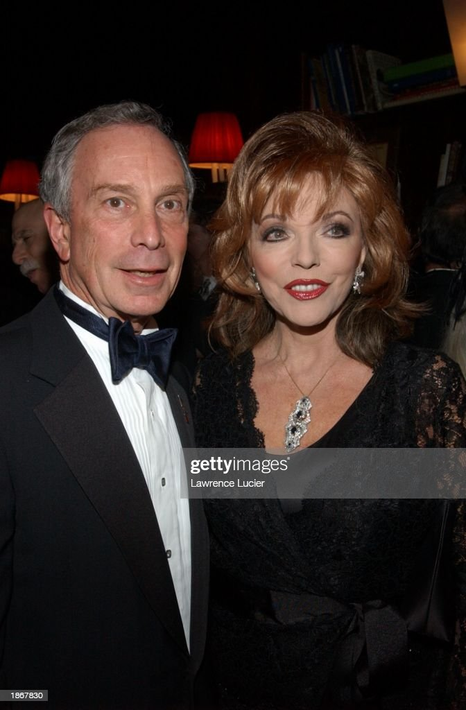 New York City Mayor Michael Bloomberg (L) and actress Joan Collins arrive at the official Academy of Motion Picture Arts & Sciences Oscar Night Viewing Party at Le Cirque 2000 restaurant March 23, 2003 in New York City.
