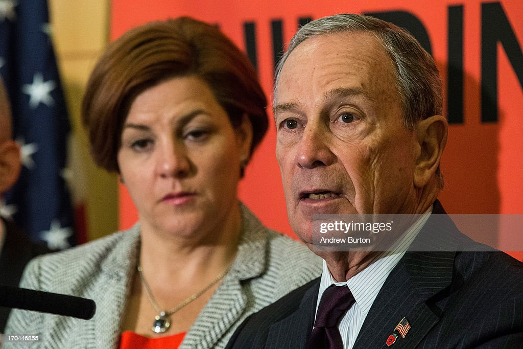 New York City Mayor Michael Bloomberg (R) and City Council Speaker and mayoral candidate, Christine Quinn, speak at a press conference announcing new recommendations for building codes to make the city safer against future flooding and storms on June 13, 2013 in the Queens borough of New York City. Following Hurricane Sandy, in October, 2012, Bloomberg and Quinn commissioned a task force to review building codes and recommend new standards.