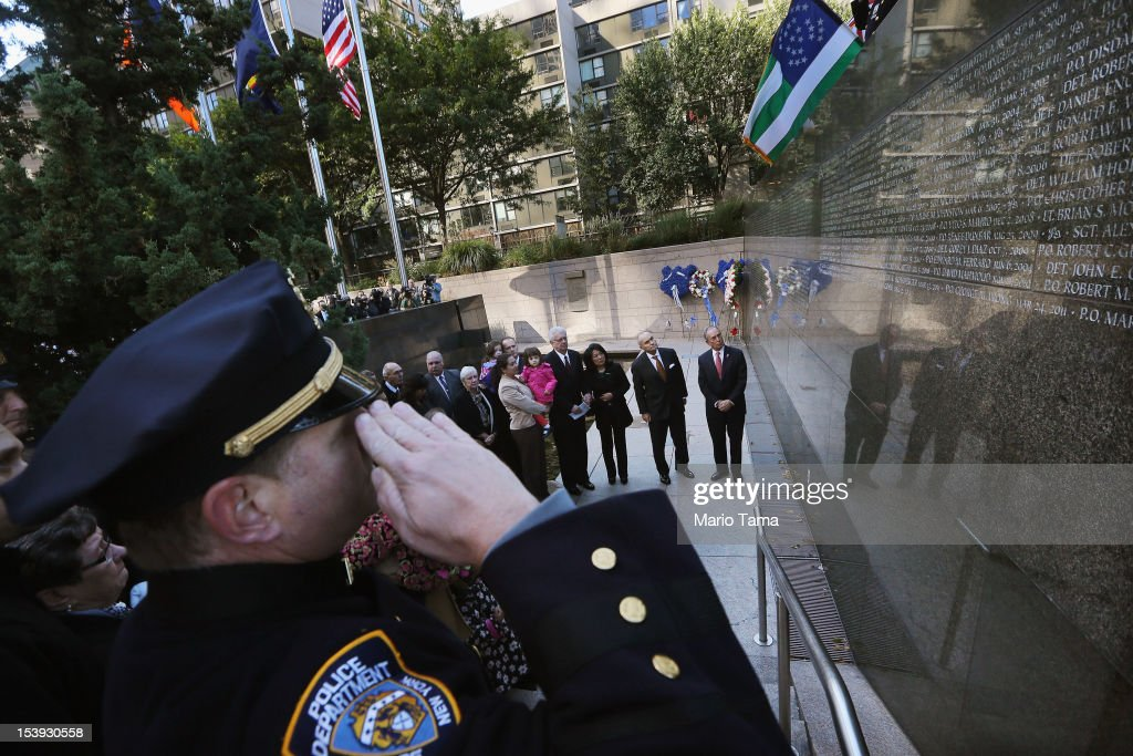 New York City Mayor Michael Bloomberg (R) and New York City Police Commissioner Ray Kelly (C) stand among family members of officers who died in the line of duty during an unveiling ceremony at the New York City Police Memorial Wall on October 11, 2012 in New York City. The city unveiled the names of fiften officers who died last year.Thirteen succumbed to illnesses as a result of September 11 and two died from violence in Brooklyn.