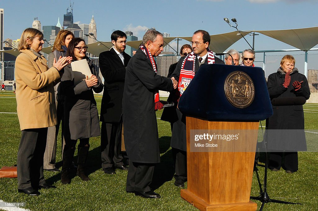 New York City Mayor <a gi-track='captionPersonalityLinkClicked' href=/galleries/search?phrase=Michael+Bloomberg&family=editorial&specificpeople=171685 ng-click='$event.stopPropagation()'>Michael Bloomberg</a> (L) and New York Red Bulls General Manager Jerome de Bontin shack hands during a ribbon-cutting ceremony at Brooklyn Bridge Park on December 13, 2012 in New York City.