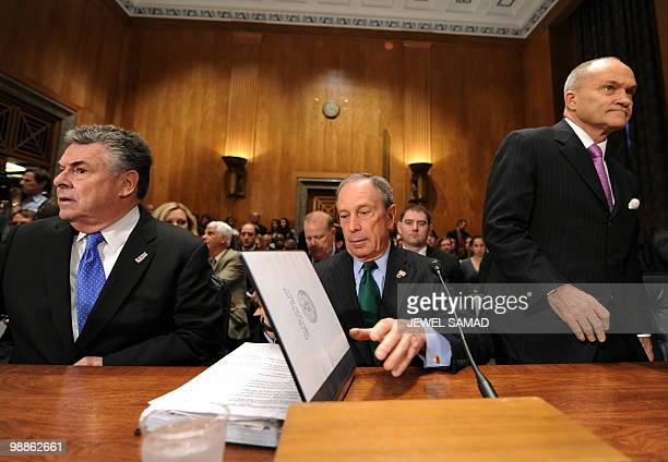 New York City Mayor Michael Bloomberg arranges his papers as New York City Police Commissioner Raymond Kelly and Rep Peter King RNY sit for a hearing...
