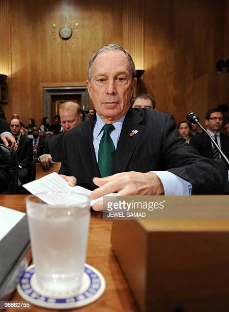 New York City Mayor Michael Bloomberg arranges his papers during a hearing on 'Terrorists and Guns The Nature of the Threat and Proposed Reforms' at...