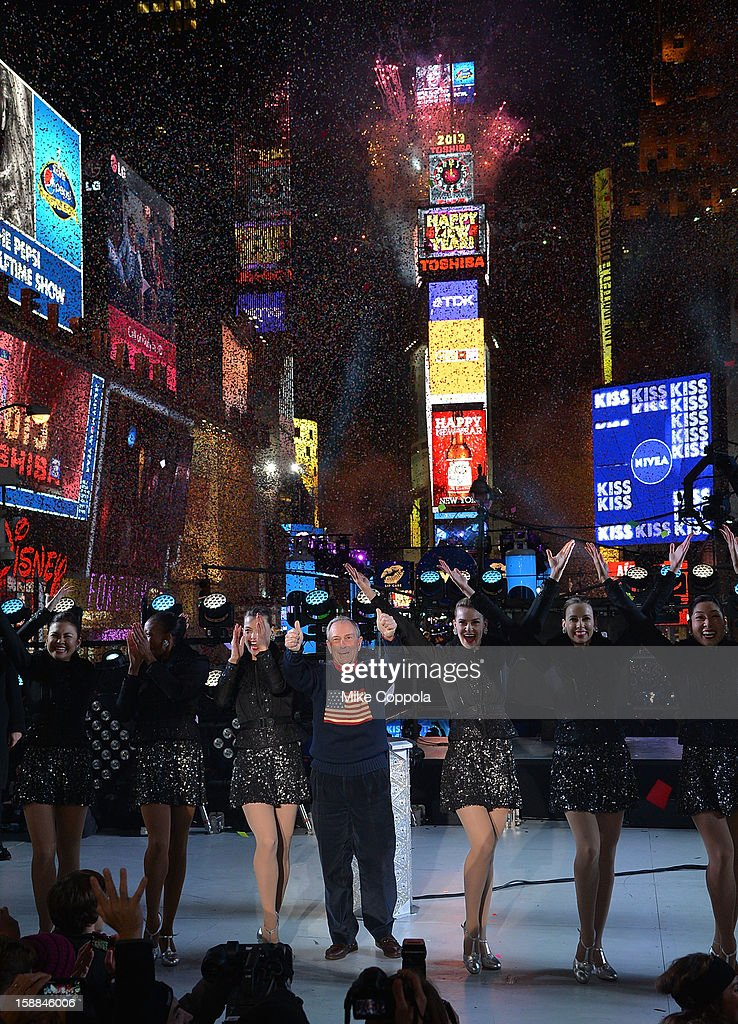 New York City Mayor <a gi-track='captionPersonalityLinkClicked' href=/galleries/search?phrase=Michael+Bloomberg&family=editorial&specificpeople=171685 ng-click='$event.stopPropagation()'>Michael Bloomberg</a> (C) celebrates New Year's Eve 2013 In Times Square with the Rockettes at Times Square on December 31, 2012 in New York City.