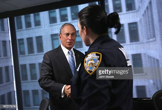 New York City Mayor Michael Bloomberg greets a counterterrorism police officer at the Lower Manhattan Security Initiative on April 23 2013 in New...