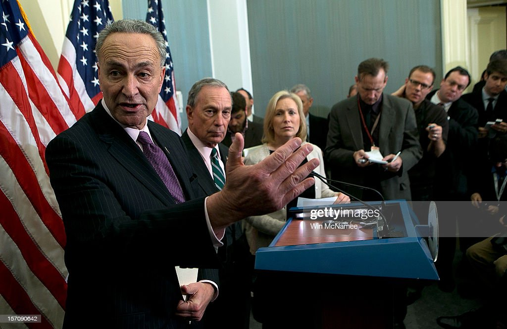 New York City Mayor <a gi-track='captionPersonalityLinkClicked' href=/galleries/search?phrase=Michael+Bloomberg&family=editorial&specificpeople=171685 ng-click='$event.stopPropagation()'>Michael Bloomberg</a> (2nd L) holds a press conference with U.S. Sen. <a gi-track='captionPersonalityLinkClicked' href=/galleries/search?phrase=Charles+Schumer&family=editorial&specificpeople=171249 ng-click='$event.stopPropagation()'>Charles Schumer</a> (D-NY) (L) and U.S. Sen. <a gi-track='captionPersonalityLinkClicked' href=/galleries/search?phrase=Kirsten+Gillibrand&family=editorial&specificpeople=4099377 ng-click='$event.stopPropagation()'>Kirsten Gillibrand</a> (D-NY) (3rd L)) at the U.S. Capitol November 28, 2012 in Washington, DC. Bloomberg and the two senators from New York met to discuss New York City's Hurricane Sandy Federal Aid Request.