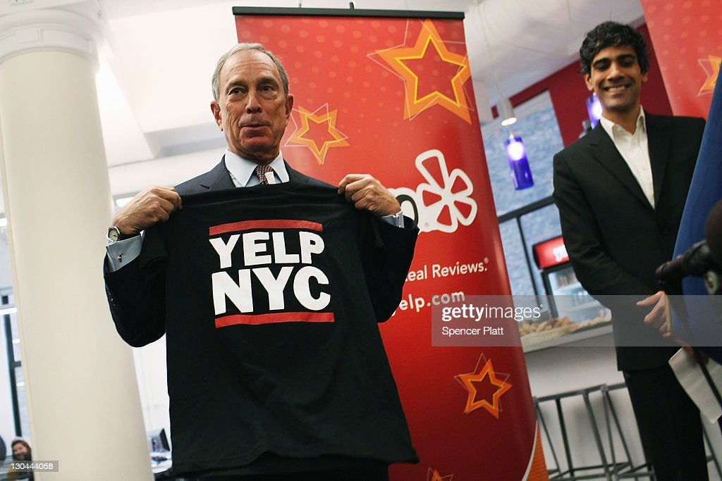 New York City Mayor <a gi-track='captionPersonalityLinkClicked' href=/galleries/search?phrase=Michael+Bloomberg&family=editorial&specificpeople=171685 ng-click='$event.stopPropagation()'>Michael Bloomberg</a> (L) holds up a t-shirt near with Yelp CEO Jeremy Stoppelman at the new East Coast headquarters of the online review company Yelp on October 26, 2011 in New York City. The Bloomberg administration has been heralding and working to facilitate the tech sector in New York City in hopes of making New York City a rival to Silicon Valley for start-up companies.