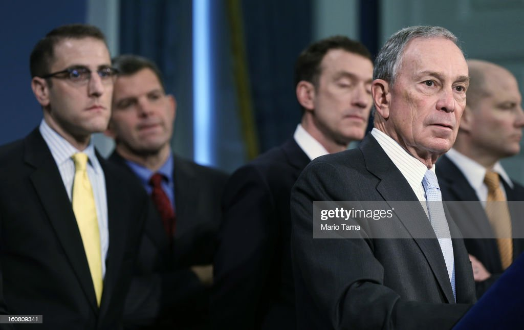 New York City Mayor <a gi-track='captionPersonalityLinkClicked' href=/galleries/search?phrase=Michael+Bloomberg&family=editorial&specificpeople=171685 ng-click='$event.stopPropagation()'>Michael Bloomberg</a> (R) listens to a question at a City Hall press conference on federal funds for Superstorm Sandy on February 6, 2013 in New York City. Bloomberg announced plans for $1.8 billion in federal funds for community block grants which include homeowner grants to repair properties, emergency generators for public housing and a competition for new storm resilient technology.