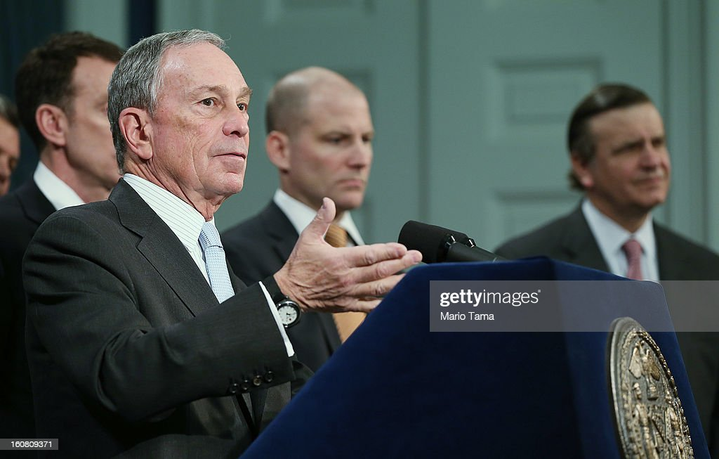 New York City Mayor <a gi-track='captionPersonalityLinkClicked' href=/galleries/search?phrase=Michael+Bloomberg&family=editorial&specificpeople=171685 ng-click='$event.stopPropagation()'>Michael Bloomberg</a> (L) listens to a question at a City Hall press conference on federal funds for Superstorm Sandy on February 6, 2013 in New York City. Bloomberg announced plans for $1.8 billion in federal funds for community block grants which include homeowner grants to repair properties, emergency generators for public housing and a competition for new storm resilient technology.