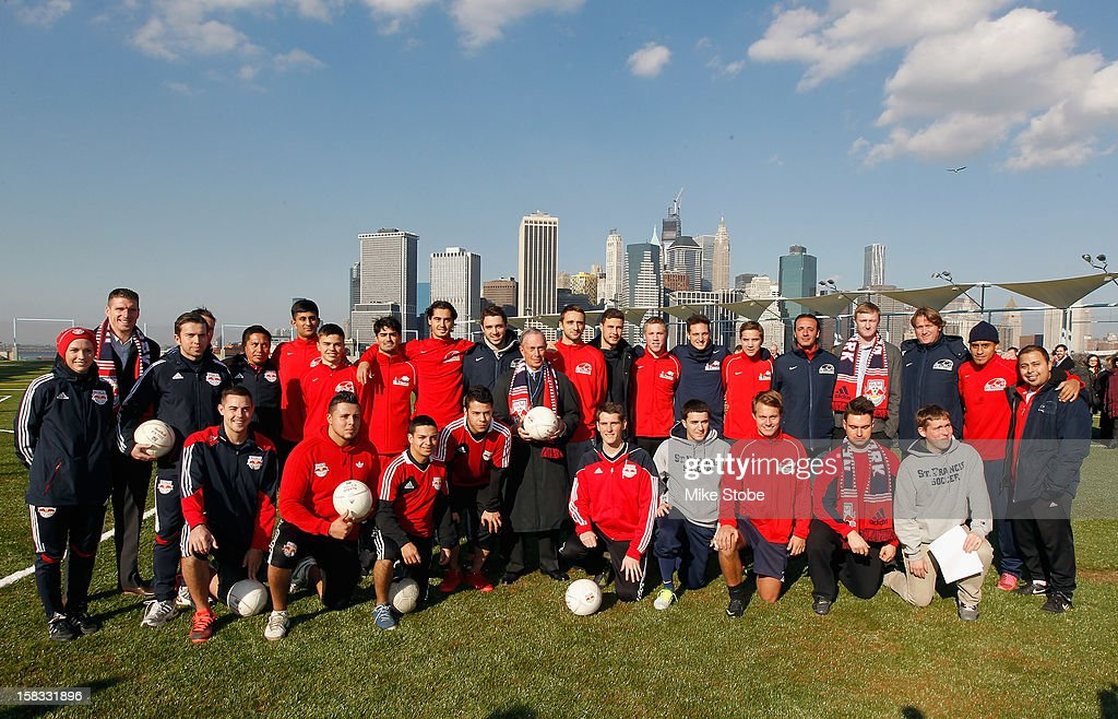 New York City Mayor Michael Bloomberg (C) poses for a photo prior to a ribbon-cutting ceremony to open a new soccer field on Brooklyn's Pier 5 on December 13, 2012 in New York City.