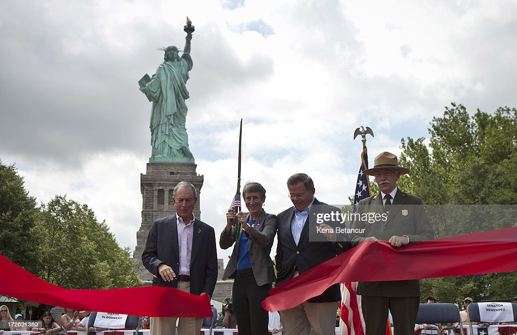 New York City Mayor <a gi-track='captionPersonalityLinkClicked' href=/galleries/search?phrase=Michael+Bloomberg&family=editorial&specificpeople=171685 ng-click='$event.stopPropagation()'>Michael Bloomberg</a>, Secretary of the Interior Sally Jewell, U.S. Sen. <a gi-track='captionPersonalityLinkClicked' href=/galleries/search?phrase=Robert+Menendez&family=editorial&specificpeople=504931 ng-click='$event.stopPropagation()'>Robert Menendez</a> (D-NJ) and Jonathan B. Jarvis, Director of the United States National Park Service cut the ribbon at the reopening ceremony of the Statue of Liberty on the first day it is open to the public after Hurricane Sandy on July 4, 2013 on the Liberty Island in New York City. The the statue was mostly spared by the storm, but the surrounding infrastructure was badly damaged.