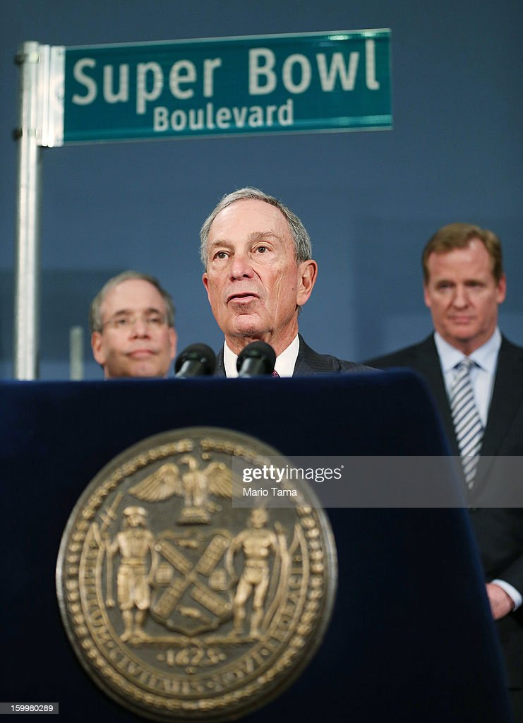 New York City Mayor Michael Bloomberg (C) speaks as National Football League (NFL) Commissioner <a gi-track='captionPersonalityLinkClicked' href=/galleries/search?phrase=Roger+Goodell&family=editorial&specificpeople=744758 ng-click='$event.stopPropagation()'>Roger Goodell</a> (R) looks on at a City Hall press conference announcing plans for Super Bowl XLVIII in the region on January 24, 2012 in New York City. The New York/New Jersey region's first Super Bowl will see the creation of a 'Super Bowl Boulevard' fan attraction along Broadway in midtown Manhattan.