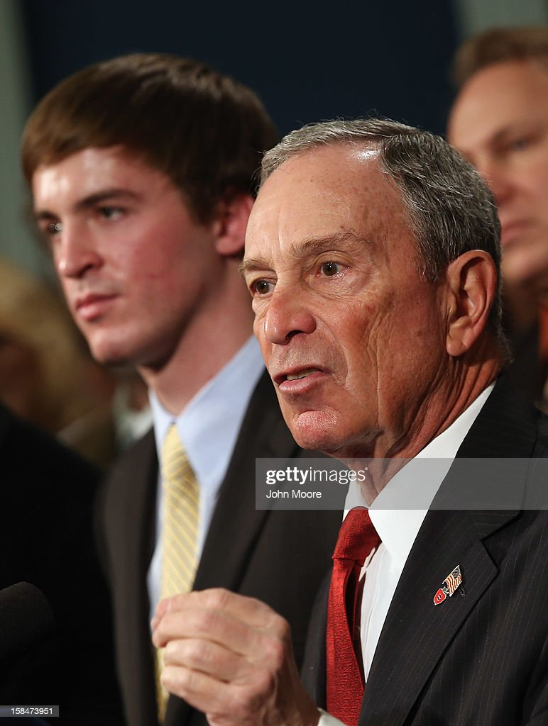 New York City Mayor <a gi-track='captionPersonalityLinkClicked' href=/galleries/search?phrase=Michael+Bloomberg&family=editorial&specificpeople=171685 ng-click='$event.stopPropagation()'>Michael Bloomberg</a> speaks in favor of stronger gun control while standing with survivors and family members of gun violence at a press conference at City Hall on December 17, 2012 in New York City. Bloomberg, co-chair of Mayors Against Gun Violence presented a series of videos called 'I Demand a Plan' highlighting personal stories representing Americans killed every day by gunfire. The mayor spoke at length about last week's mass murder in Newtown, CT.