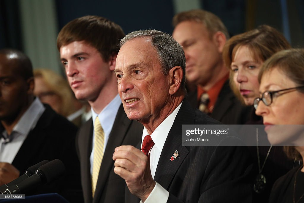 New York City Mayor <a gi-track='captionPersonalityLinkClicked' href=/galleries/search?phrase=Michael+Bloomberg&family=editorial&specificpeople=171685 ng-click='$event.stopPropagation()'>Michael Bloomberg</a> speaks in favor of stronger gun control while standing with survivors and family members of gun violence at a press conference at City Hall on December 17, 2012 in New York City. Bloomberg, co-chair of Mayors Against Gun Violence presented a series of videos called 'I Demand a Plan' highlighting personal stories representing Americans killed every day by gunfire. The mayor spoke at length condemning last week's mass murder in Newtown, CT.