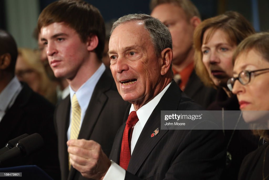 New York City Mayor <a gi-track='captionPersonalityLinkClicked' href=/galleries/search?phrase=Michael+Bloomberg&family=editorial&specificpeople=171685 ng-click='$event.stopPropagation()'>Michael Bloomberg</a> speaks while standing with survivors and family members of gun violence at a press conference at City Hall on December 17, 2012 in New York City. Bloomberg, co-chair of Mayors Against Gun Violence presented a series of videos called 'I Demand a Plan' highlighting personal stories representing Americans killed every day by gunfire. The mayor spoke at length about last week's mass murder in Newtown, CT.
