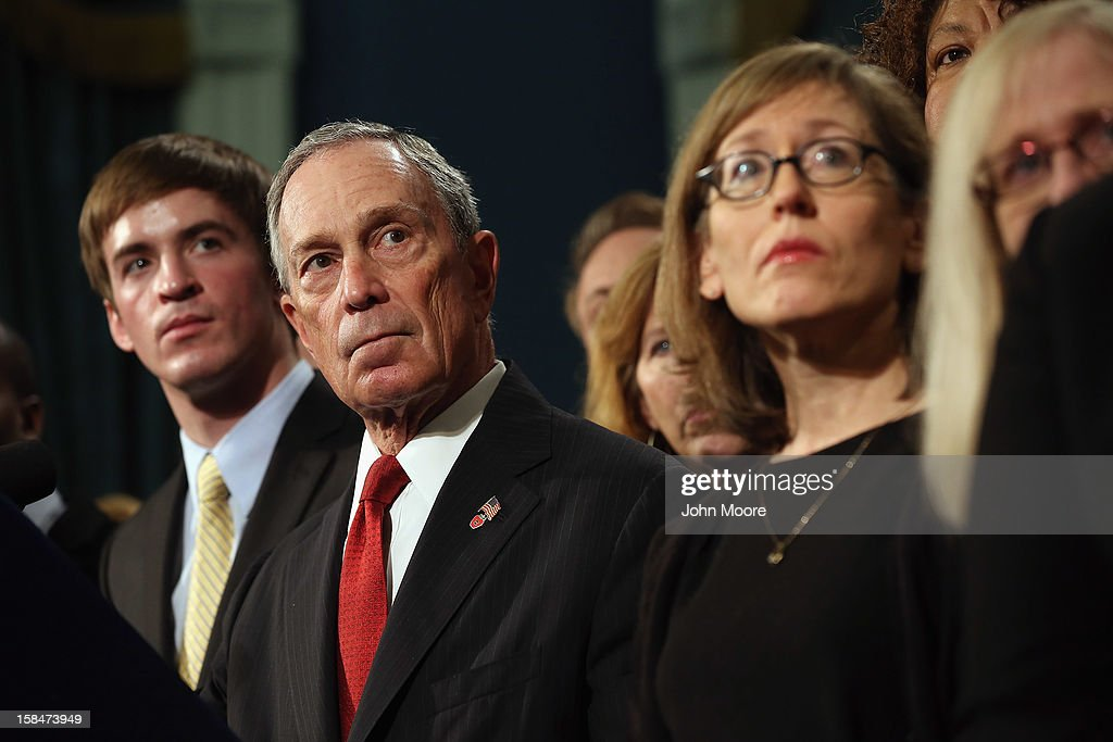 New York City Mayor <a gi-track='captionPersonalityLinkClicked' href=/galleries/search?phrase=Michael+Bloomberg&family=editorial&specificpeople=171685 ng-click='$event.stopPropagation()'>Michael Bloomberg</a> stands with survivors and family members of gun violence at a press conference at City Hall on December 17, 2012 in New York City. Bloomberg, co-chair of Mayors Against Gun Violence presented a series of videos called 'I Demand a Plan' highlighting personal stories representing Americans killed every day by gunfire. The mayor spoke at length about last week's mass murder in Newtown, CT.