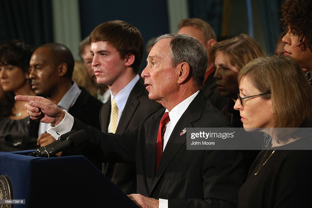 New York City Mayor <a gi-track='captionPersonalityLinkClicked' href=/galleries/search?phrase=Michael+Bloomberg&family=editorial&specificpeople=171685 ng-click='$event.stopPropagation()'>Michael Bloomberg</a> takes a question while standing with survivors and family members of gun violence at a press conference at City Hall on December 17, 2012 in New York City. Bloomberg, co-chair of Mayors Against Gun Violence presented a series of videos called 'I Demand a Plan' highlighting personal stories representing Americans killed every day by gunfire. The mayor spoke at length about last week's mass murder in Newtown, CT.