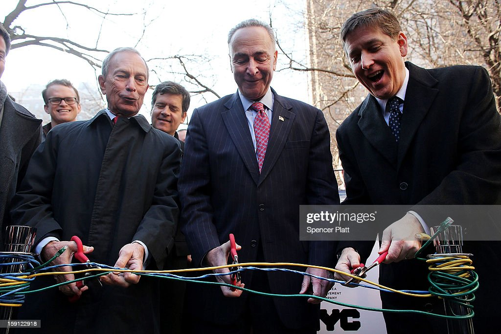 New York City Mayor <a gi-track='captionPersonalityLinkClicked' href=/galleries/search?phrase=Michael+Bloomberg&family=editorial&specificpeople=171685 ng-click='$event.stopPropagation()'>Michael Bloomberg</a> (left), U.S. Sen. <a gi-track='captionPersonalityLinkClicked' href=/galleries/search?phrase=Charles+Schumer&family=editorial&specificpeople=171249 ng-click='$event.stopPropagation()'>Charles Schumer</a> (D-NY) and Ben Fried, Chief Information Officer for Google, (right), cut ethernet cables at a news event where it was announced that free Wi-Fi will be provided to the Manhattan neighborhood of Chelsea on January 8, 2013 in New York City. Google has teamed up with the Chelsea Improvement Project, a local New York City non-profit and the city government to provide free Wi-Fi to the historic neighborhood. The network will become the largest public outdoor service of its kind in New York, and the first neighborhood in the city with free WiFi.