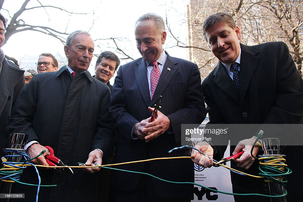 New York City Mayor Michael Bloomberg (left), U.S. Sen. Charles Schumer (D-NY) and Ben Fried, Chief Information Officer for Google, (right), cut ethernet cables at a news event where it was announced that free Wi-Fi will be provided to the Manhattan neighborhood of Chelsea on January 8, 2013 in New York City. Google has teamed up with the Chelsea Improvement Project, a local New York City non-profit and the city government to provide free Wi-Fi to the historic neighborhood. The network will become the largest public outdoor service of its kind in New York, and the first neighborhood in the city with free WiFi.