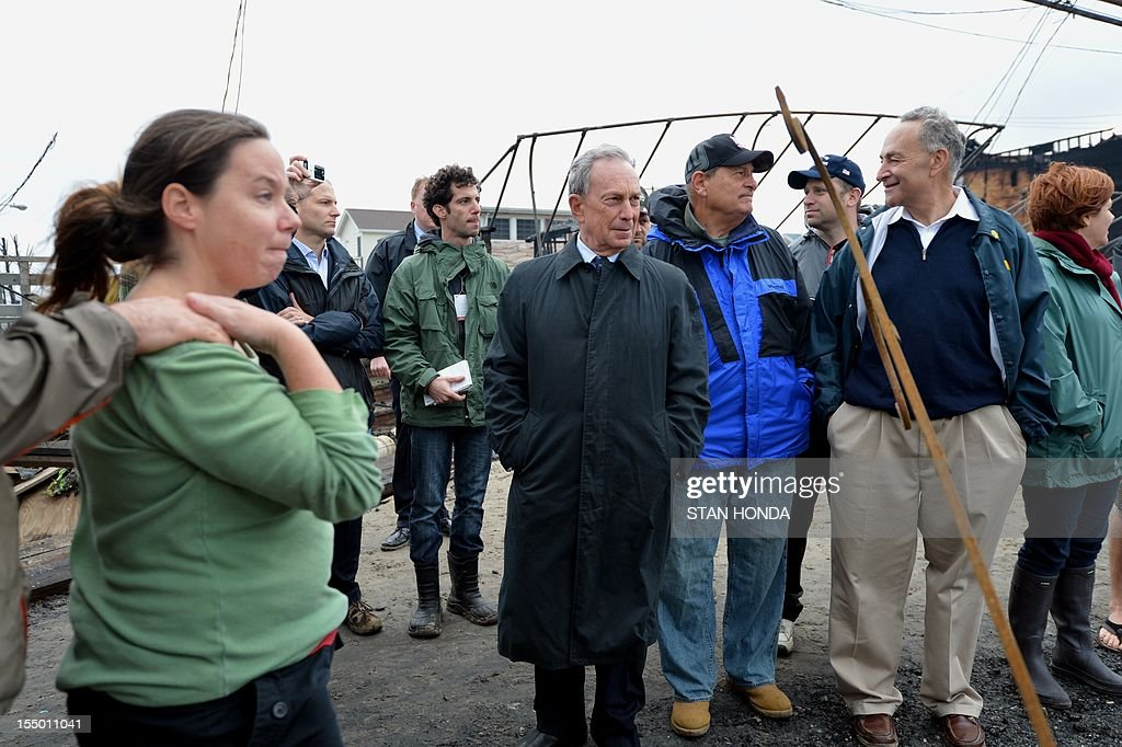 New York City Mayor Michael Bloomberg (C), US Senator Charles Schumer (2nd R) and New York City Council Speaker Christine Quinn (R) view damage in the Breezy Point area of Queens in New York on October 30, 2012 after fire destroyed about 80 homes as a result of Hurricane Sandy which hit the area on October 29. The death toll from superstorm Sandy has risen to 35 in the United States and Canada, and was expected to climb further as several people remained missing, officials said. Officials in the states of Connecticut, Maryland, New York, New Jersey, North Carolina, Pennsylvania, Virginia and West Virginia all reported deaths from the massive storm system, while Toronto police said a Canadian woman was killed by flying debris. AFP PHOTO/Stan HONDA