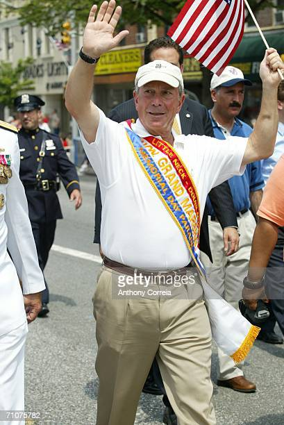 New York City Mayor Michael Bloomberg waves to parade goers as he participates in the Little Neck/Douglaston Memorial Day Parade May 29 2006 in the...