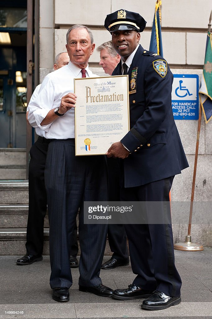 New York City mayor Michael R. Bloomberg (L) and New York Police Department Inspector <a gi-track='captionPersonalityLinkClicked' href=/galleries/search?phrase=Rodney+Harrison&family=editorial&specificpeople=211203 ng-click='$event.stopPropagation()'>Rodney Harrison</a> attend National Night Out on the streets of Manhattan on August 7, 2012 in New York City.