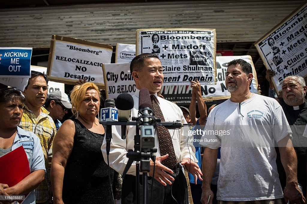 New York City mayoral candidate and former city comptroller John Liu, speaks at a protest against the eviction of over two hundred small businesses on August 2, 2013 in the Willet's Point neighborhood of the Queens borough of New York City. The neighborhood has been in a battle with the city of New York for years, which hopes to demolish the neighborhood and invest $3 billion for a mall, apartments and more parking for nearby Citi Field. Members of the neighborhood argue that hundreds of small businesses are established in the neighborhood and should not be evicted.