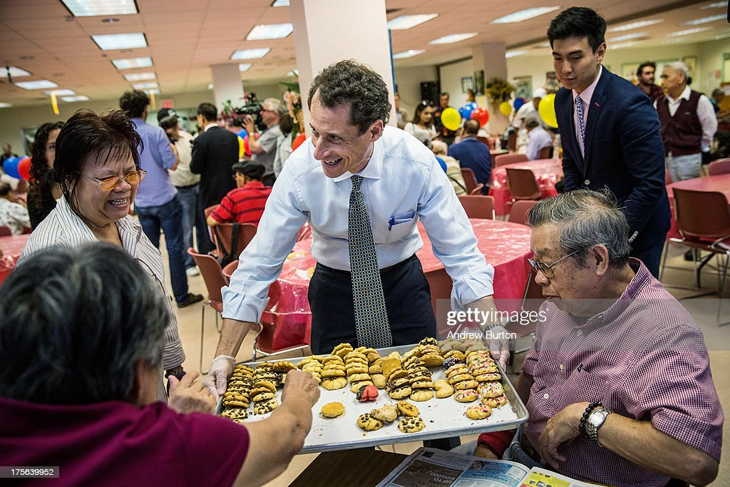 New York City mayoral candidate and former U.S. Rep. <a gi-track='captionPersonalityLinkClicked' href=/galleries/search?phrase=Anthony+Weiner&family=editorial&specificpeople=821661 ng-click='$event.stopPropagation()'>Anthony Weiner</a> (D-NY) hands out cookies to seniors at Elmhurst Senior Center on August 5, 2013 in New York City. Weiner's polling numbers in the mayoral race have declined precipitously since he admitted to continuing to send graphic sexual messages and photos with numerous women after similiar activities made him step down from U.S. Congress in 2009.