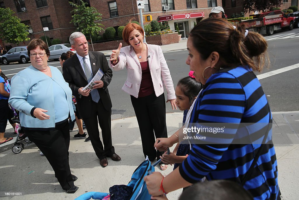 New York City mayoral candidate <a gi-track='captionPersonalityLinkClicked' href=/galleries/search?phrase=Christine+Quinn&family=editorial&specificpeople=550180 ng-click='$event.stopPropagation()'>Christine Quinn</a> (C) meets potential voters outside a school on September 9, 2013 in the Queens borough of New York City. Quinn, a Democrat, and other candidates made a final voter push ahead of Tuesday's primary election in New York City's vote for mayor.