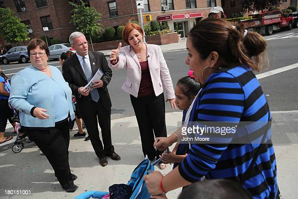 New York City mayoral candidate Christine Quinn meets potential voters outside a school on September 9 2013 in the Queens borough of New York City...