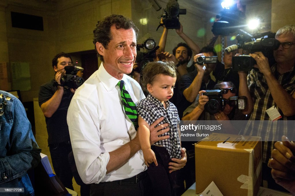 New York City mayoral hopeful <a gi-track='captionPersonalityLinkClicked' href=/galleries/search?phrase=Anthony+Weiner&family=editorial&specificpeople=821661 ng-click='$event.stopPropagation()'>Anthony Weiner</a> arrives at his polling station with his son, Jordan Weiner, to vote in the Democratic primary on September 10, 2013 in New York City. Weiner ran into a minor issue while voting this morning: a required signature proving he was <a gi-track='captionPersonalityLinkClicked' href=/galleries/search?phrase=Anthony+Weiner&family=editorial&specificpeople=821661 ng-click='$event.stopPropagation()'>Anthony Weiner</a> was not on file at the local polling station. The problem was soon solved by the Board of Elections.