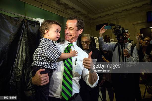 New York City mayoral hopeful Anthony Weiner exits the voting booth with his son Jordan Weiner after voting at his polling station on September 10...