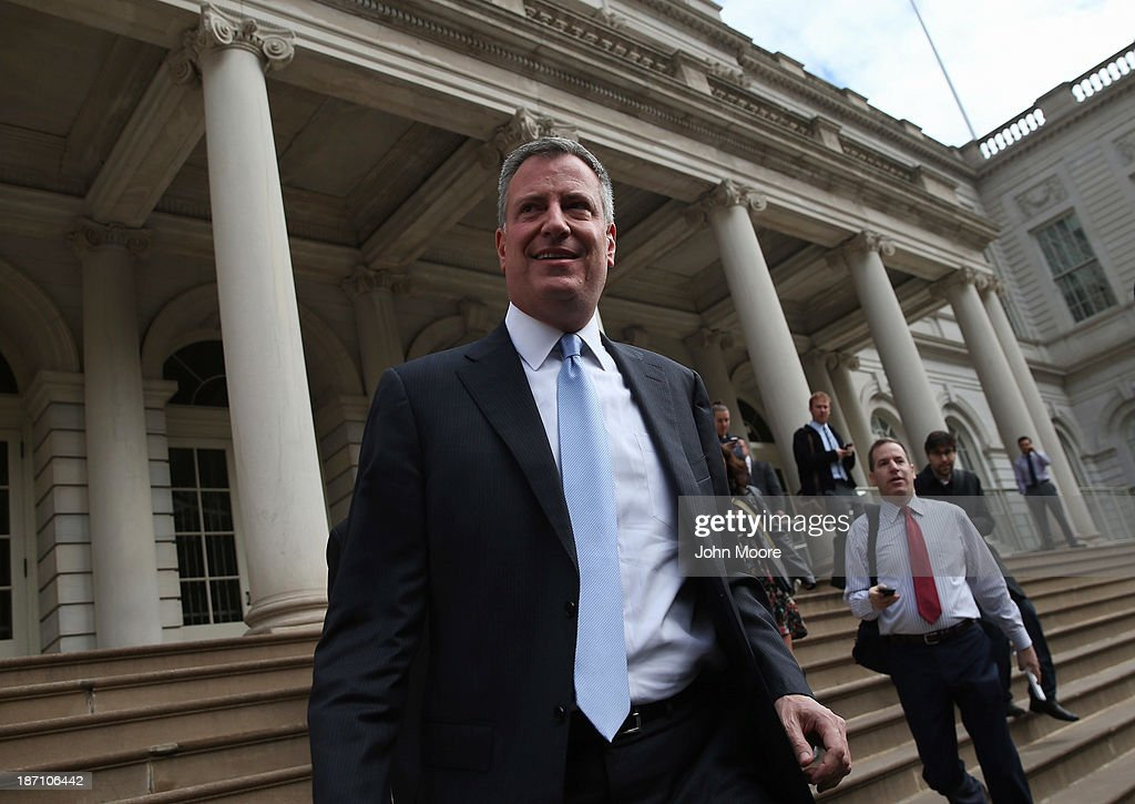 New York City Mayor-elect <a gi-track='captionPersonalityLinkClicked' href=/galleries/search?phrase=Bill+de+Blasio&family=editorial&specificpeople=6224514 ng-click='$event.stopPropagation()'>Bill de Blasio</a> leaves City Hall after meeting with outgoing Mayor Michael Bloomberg on November 6, 2013 in New York City. It was the first meeting between the two since de Blasio's election victory the day before.