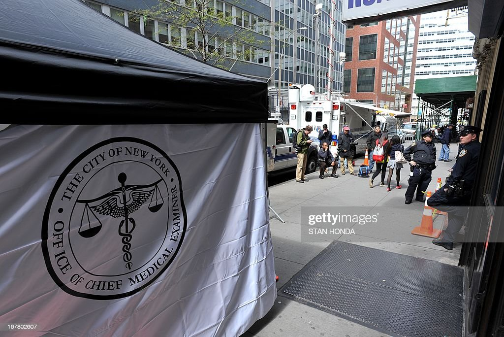 A New York City Medical Examiner tent is seen outside a site April 30, 2013 in Lower Manhattan where New York police said that they have found a fragment of one of two airplanes that slammed into the World Trade Center on September 11, 2001. The fragment was found April 27 and the medical examiner will be searching for possible human remains before the part of the plane is removed. AFP PHOTO/Stan HONDA
