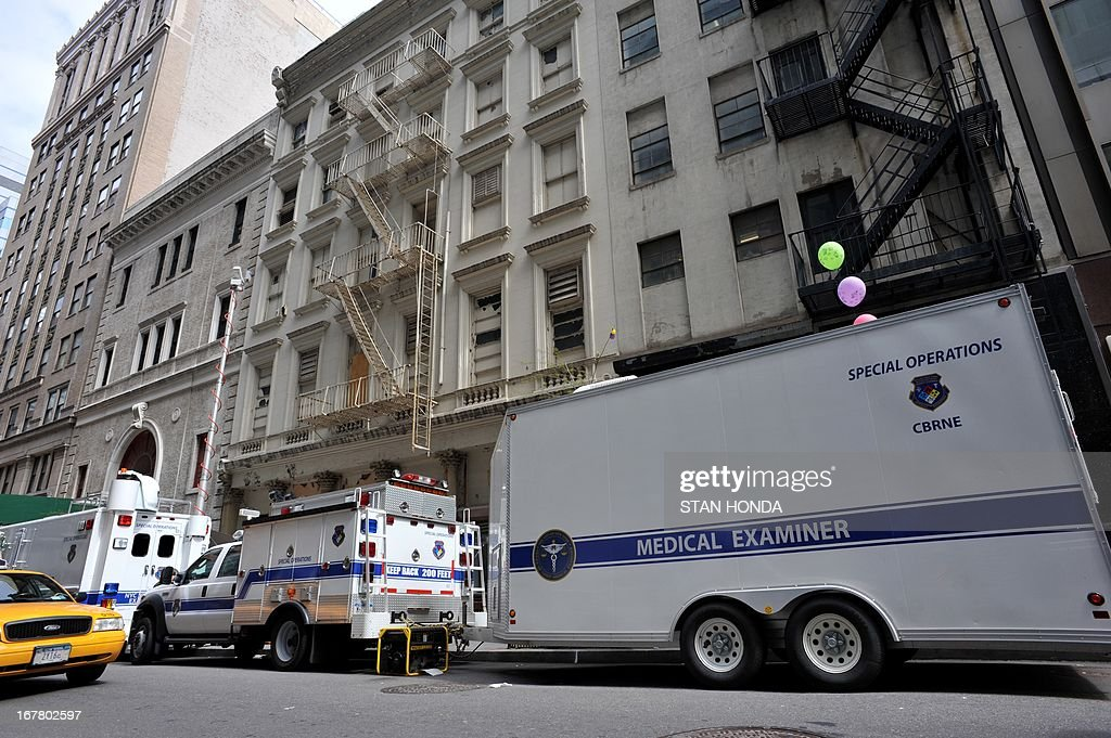 New York City Medical Examiner vehicles are seen outside a site April 30, 2013 in Lower Manhattan where New York police said that they have found a fragment of one of two airplanes that slammed into the World Trade Center on September 11, 2001. The fragment was found April 27 and the medical examiner will be searching for possible human remains before the part of the plane is removed. AFP PHOTO/Stan HONDA