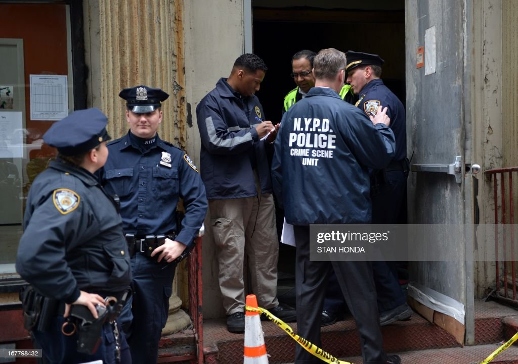 New York City officials enter a site April 30, 2013 in Lower Manhattan where New York police said that they have found a fragment of one of two airplanes that slammed into the World Trade Center on September 11, 2001. The fragment was found April 27 and the medical examiner will be searching for possible human remains before the part of the plane is removed. AFP PHOTO/Stan HONDA