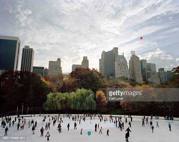 USA, New York City, people ice skating in Central Park