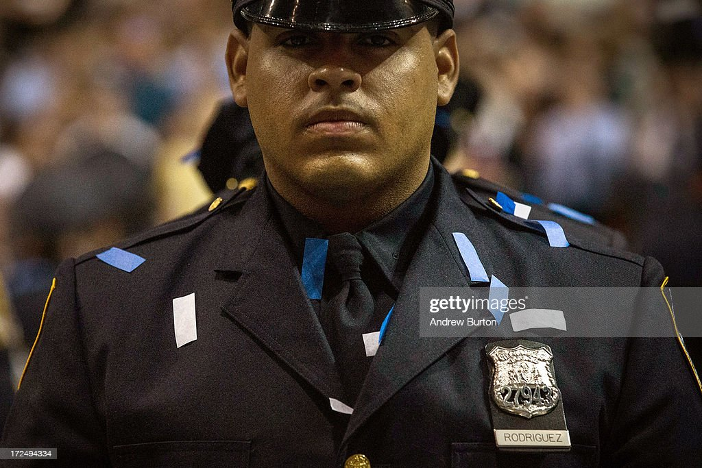 A New York City Police Academy cadet stands at attention during his graduation ceremony at the Barclays Center on July 2, 2013 in the Brooklyn borough of New York City. The New York Police Department (NYPD) has more than 37,000 officers; 781 cadets graduated today.