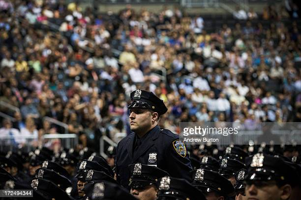 New York City Police Academy cadets attend their graduation ceremony at the Barclays Center on July 2 2013 in the Brooklyn borough of New York City...