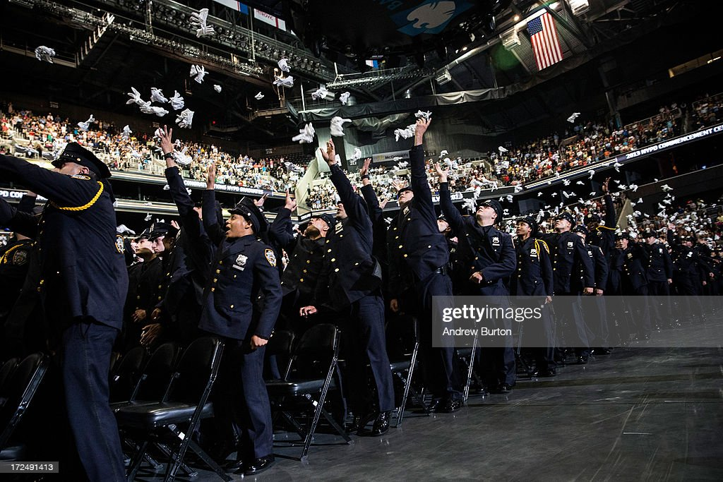 New York City Police Academy cadets celebrate after their graduation ceremony at the Barclays Center on July 2, 2013 in the Brooklyn borough of New York City. The New York Police Department (NYPD) has more than 37,000 officers; 781 cadets graduated today.