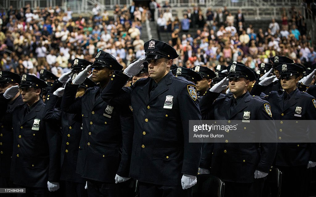 New York City Police Academy cadets salute during their graduation ceremony at the Barclays Center on July 2, 2013 in the Brooklyn borough of New York City. The New York Police Department (NYPD) has more than 37,000 officers; 781 cadets graduated today.
