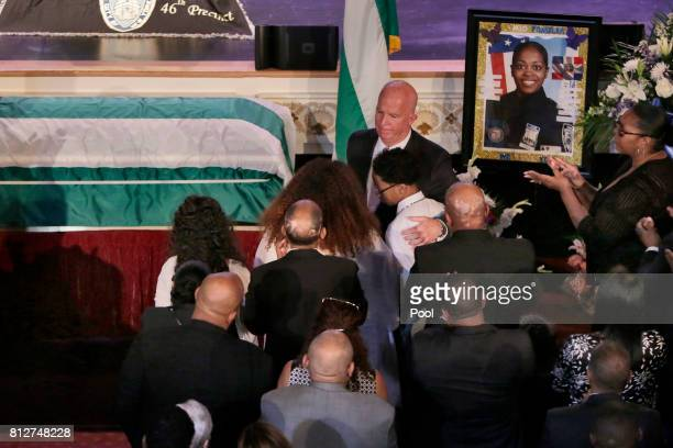 New York City Police Commissioner James O'Neil consoles the son of New York City Police Officer Miosotis Familia during her funeral at the World...