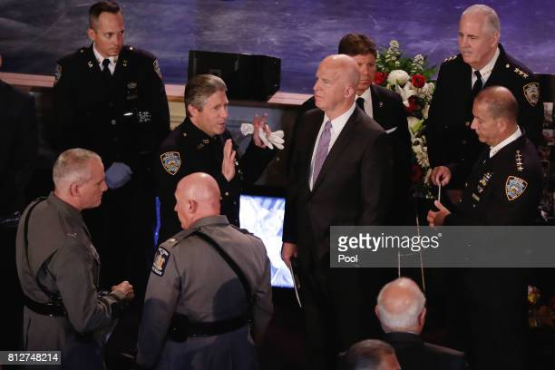 New York City Police Commissioner James O'Neill right center and President of the Patrolmen's Benevolent Association Pat Lynch left center ge...